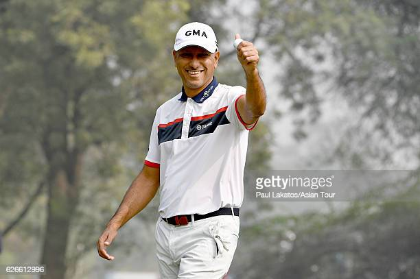 Jeev Milkha SIngh of India plays a shot in the ProAm during the Panasonic Open India at Delhi Golf Club on November 30 2016 in New Delhi India