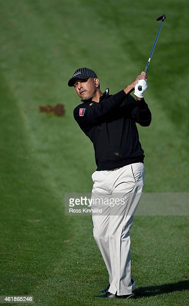 Jeev Milkha Singh of India plays his second shot on the par four 2nd hole during the first round of the Commercial Bank Qatar Masters at the Doha...