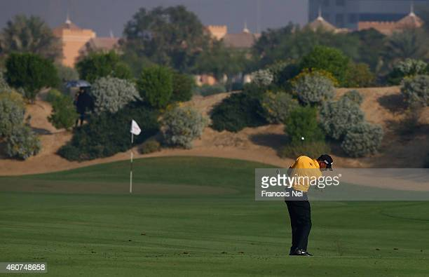 Jeev Milkha Singh of India plays his second shot the first hole during the final round of the Dubai Open at The Els Club Dubai on December 21 2014 in...