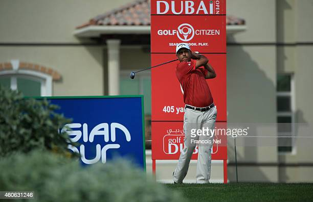Jeev Milkha Singh of India plays his tee shot on the 6th hole during the first round of the Dubai Open at The Els Club Dubai on December 18 2014 in...