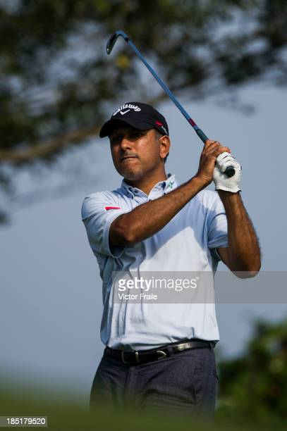 Jeev Milkha Singh of India tees off on the 14th hole during day two of the Venetian Macau Open at Macau Golf and Country Club on October 18 2013 in...