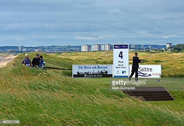 Jeev Milkha Singh of India watches his tee shot from the picturesque 4rd tee during the first day of the Saltire Energy Paul Lawrie Matchplay at...