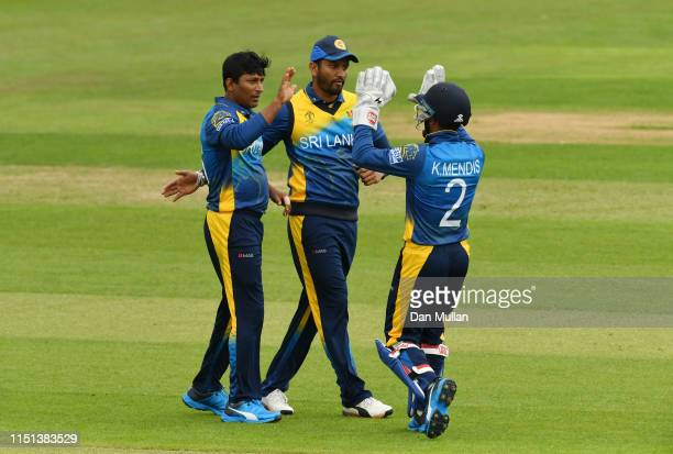 Jeevan Mendis of Sri Lanka celebrates taking the wicket of Hashim Amla of South Africa during the ICC Cricket World Cup 2019 Warm Up match between...