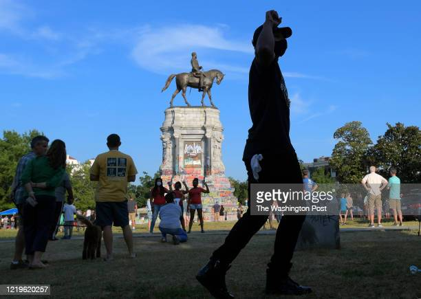 Jefe Long of Charlotte NC, dances a he makes a hip hop video at the Robert E. Lee Statue that was scheduled to be dismantled asap; the process has...