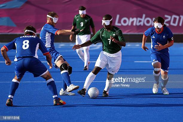 Jeferson da Conceicao Goncalves of Brazil goes past the french midfield in the gold medal match during the 5 aside Football on day 10 of the London...