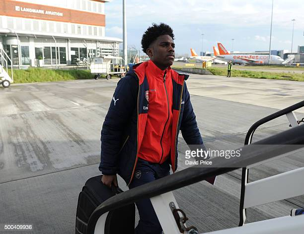 Jeff Aaron Eyoma of Arsenal boards the plane at Luton Airport on December 8 2015 in Luton England