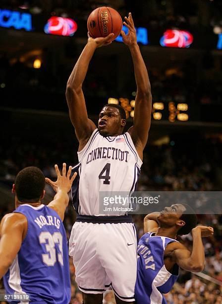 Jeff Adrien of the Connecticut Huskies puts up a jumpshot over Randolph Morris and Rajon Rondo both of the Kentucky Wildcats during the Second Round...