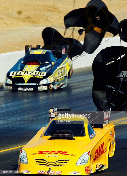 Jeff Arend races Cruz Pedregon in a qualifying round for Funny cars during the FRAMAutolite NHRA Nationals on July 17 2010 at Infineon Raceway in...
