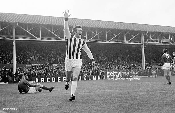 Jeff Astle celebrates after scoring for West Bromwich Albion against Manchester United during their First Division match at the Hawthorns in West...