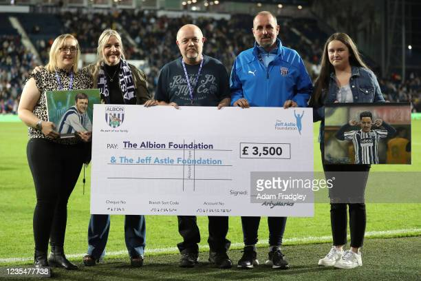 Jeff Astle Foundation presented with a cheque from Arty Marks - Mark Ward pictured with the daughter of Jeff Astel - Dawn Astle and Paul Glover from...
