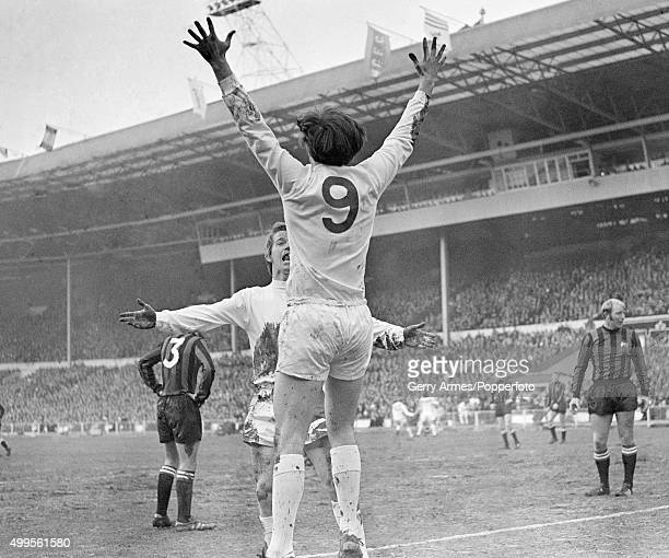 Jeff Astle has scored for West Bromwich Albion and celebrates with Colin Suggett during the League Cup Final between Manchester City and West...