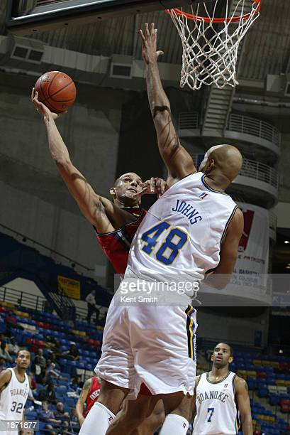 Jeff Aubry of the Fayetteville Patriots reaches past Darrell Johns of the Roanoke Dazzle during the NBDL Playoffs at the Crown Coliseum on March 25,...