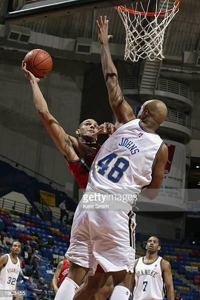 Jeff Aubry of the Fayetteville Patriots shoots challenged by Darrell Johns of the Roanoke Dazzle during Game One of the NBDL Semifinals at the Crown...