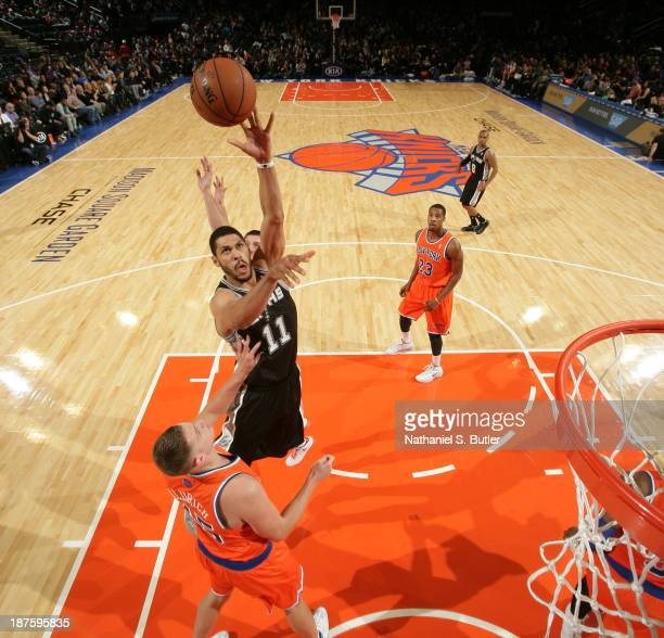 Jeff Ayers of the San Antonio Spurs shoots over Cole Aldrich of the New York Knicks during a game at the newly transformed Madison Square Garden in...