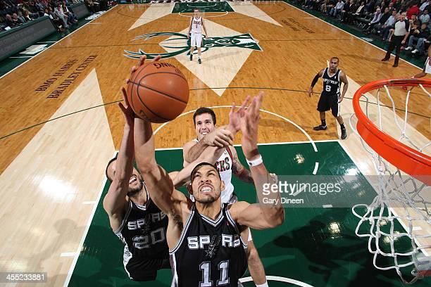 Jeff Ayres of the San Antonio Spurs rebounds against the Milwaukee Bucks on December 11 2013 at the BMO Harris Bradley Center in Milwaukee Wisconsin...