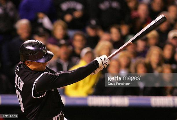 Jeff Baker of the Colorado Rockies hits the game winning RBI single against the Philadelphia Phillies during the eighth inning of Game Three of the...