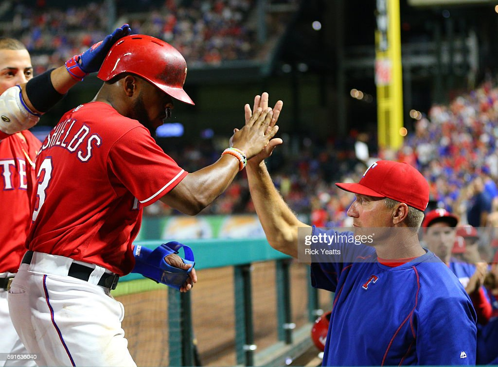 Jeff Banister #28 manager of the Texas Rangers congratulates Delino DeShields #3 for scoring in the seventh inning against the Oakland Athletics at Globe Life Park in Arlington on August 17, 2016 in Arlington, Texas.