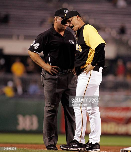 Jeff Banister of the Pittsburgh Pirates argues a call after a close play at third with Sam Holbrook against the St Louis Cardinals during the game on...