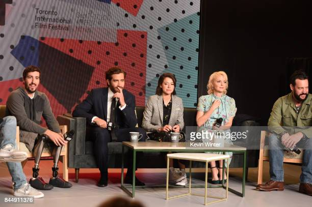 Jeff Bauman actors Jake Gyllenhaal Tatiana Maslany Miranda Richardson and screenwriter John Pollono attend the Stronger press conference during 2017...