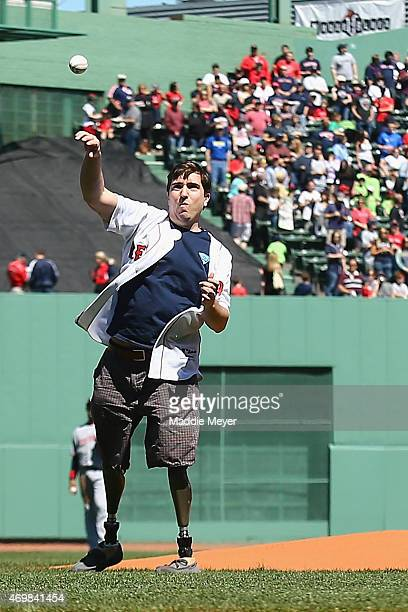 Jeff Bauman, Boston Marathon Bombing survivor, throws out the first pitch before the game between the Boston Red Sox and the Washington Nationals at...