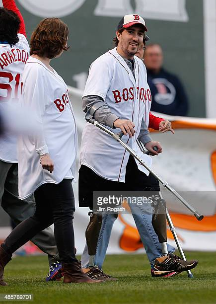 Jeff Bauman survivor of the 2013 Boston Marathon bombing reacts during a ceremony at Fenway Park before a game between Boston Red Sox and the...