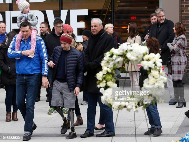 Jeff Bauman walks past a wreath laid for the victims of the Marathon bombing on April 15 the five year anniversary of the Boston Marathon bombing