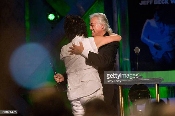 Jeff Beck hugs presenter Jimmy Page onstage during the 24th Annual Rock and Roll Hall of Fame Induction Ceremony at Public Hall on April 4 2009 in...