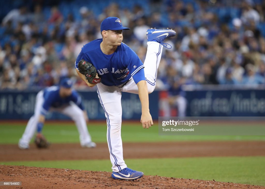 Jeff Beliveau #36 of the Toronto Blue Jays delivers a pitch in the sixth inning during MLB game action against the Tampa Bay Rays at Rogers Centre on June 13, 2017 in Toronto, Canada.