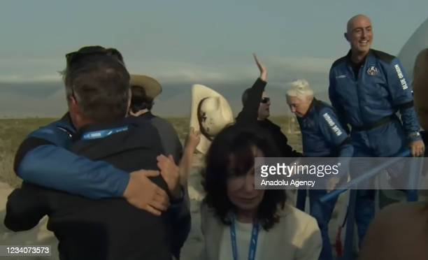 Jeff Bezos along with his brother Mark Bezos, 18-year-old Oliver Daemen, and 82-year-old Wally Funk leave Blue Originâs New Shepard crew capsule...