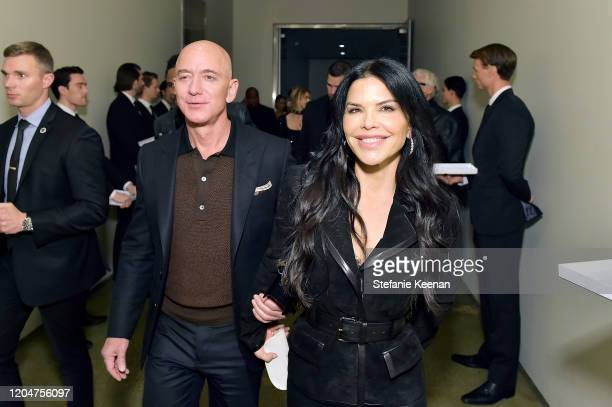 Jeff Bezos and Lauren Sanchez attend Tom Ford Autumn/Winter 2020 Runway Show at Milk Studios on February 07 2020 in Los Angeles California