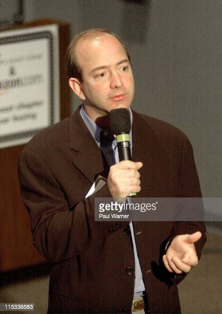 Jeff Bezos CEO of Amazoncom talks to reporters during a press conference announcing Amazoncom and Greenlightcom uniting to launch a online car buying...