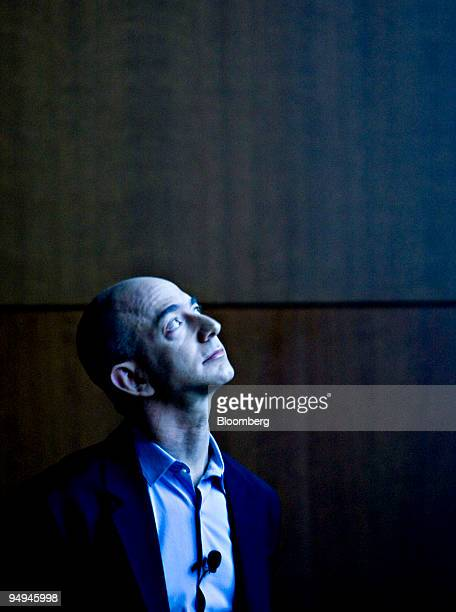 Jeff Bezos chairman president and chief executive officer of Amazoncom Inc watches a video presentation during a news conference in New York US on...