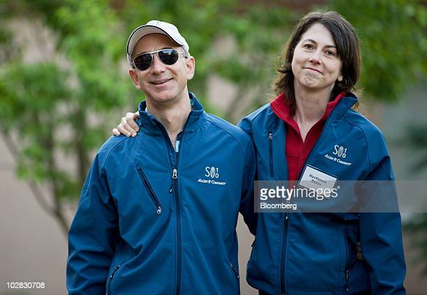 Jeff Bezos chairman president and chief executive officer of Amazoncom Inc and wife MacKenzie Bezos arrive for morning sessions at the 28th annual...