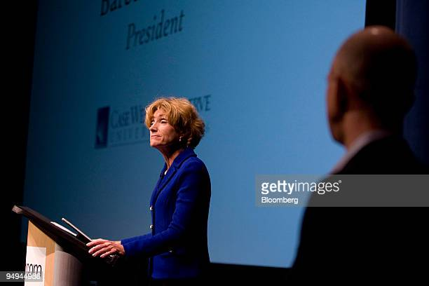 Jeff Bezos chairman president and chief executive officer of Amazoncom Inc right listens to Barbara Snyder president of Case Western Reserve...