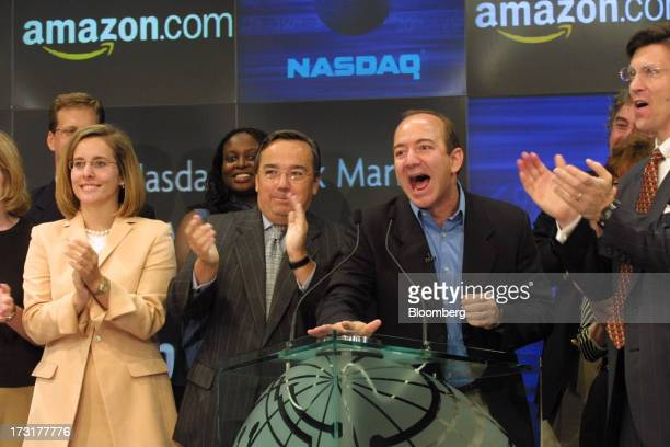 Jeff Bezos chairman president and chief executive officer of Amazoncom second right rings the bell to open the trading session at the Nasdaq...