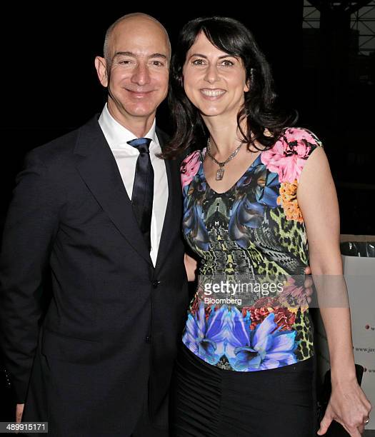 Jeff Bezos chief executive officer Amazoncom Inc and his wife Mackenzie Bezos arrive at the Robin Hood Foundations annual benefit in New York US on...