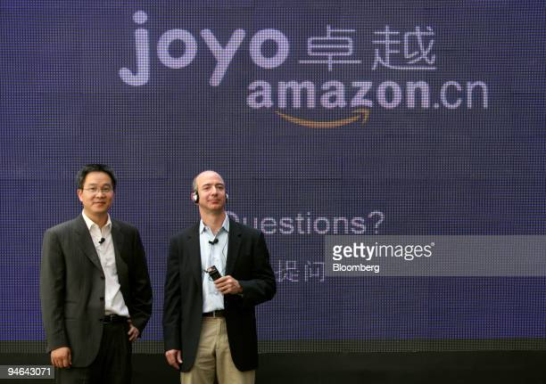 Jeff Bezos chief executive officer and founder of Amazoncom Inc right and Wang Hanhua president of Joyocom Ltd speak at a news conference in Beijing...