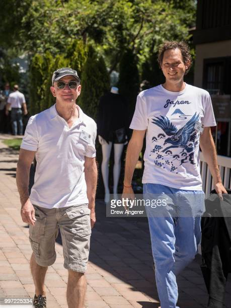 Jeff Bezos chief executive officer of Amazon and John Elkann chairman of Fiat Chrysler Automobiles walk together during the annual Allen Company Sun...