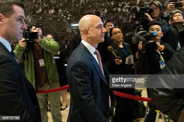 Jeff Bezos chief executive officer of Amazon arrives for a meeting with Presidentelect Donald Trump at Trump Tower December 14 2016 in New York City...