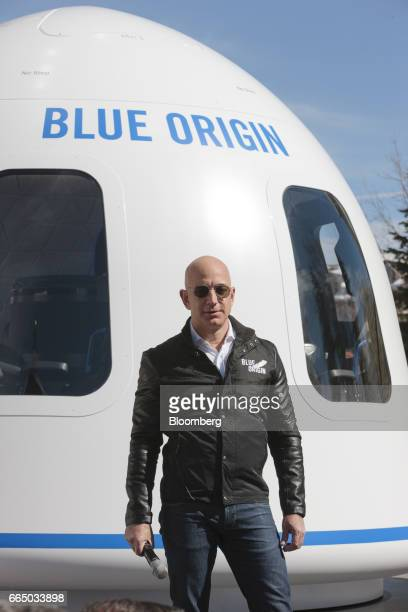 Jeff Bezos, chief executive officer of Amazon.com Inc. And founder of Blue Origin LLC, pauses while speaking at the unveiling of the Blue Origin New...