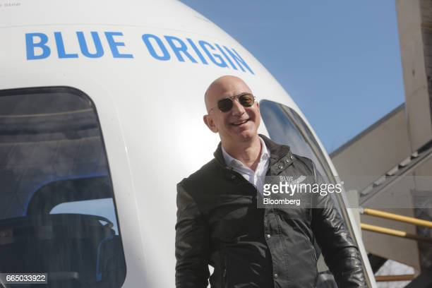 Jeff Bezos, chief executive officer of Amazon.com Inc. And founder of Blue Origin LLC, smiles while speaking at the unveiling of the Blue Origin New...