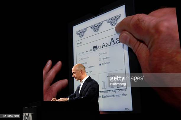 Jeff Bezos chief executive officer of Amazoncom Inc introduces the Kindle Paperwhite tablet at a news conference in Santa Monica California US on...
