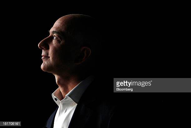 Jeff Bezos chief executive officer of Amazoncom Inc watches a video of the new Kindle Fire HD tablet at a news conference in Santa Monica California...