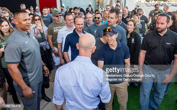 Jeff Bezos Founder And Ceo Of Amazon Bottom Shakes Hands With