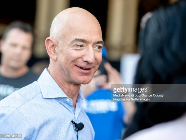 Jeff Bezos founder and CEO of Amazon speaks with employees after he made a surprise appearance during a Amazon Veterans Day celebration honoring the...