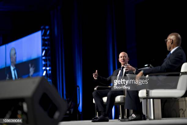 Jeff Bezos founder and chief executive officer of Amazoncom Inc second right speaks during a discussion at the Air Force Association's Air Space and...
