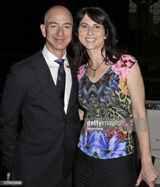 Jeff Bezos founder and chief executive officer of Amazoncom Inc and his wife Mackenzie Bezos arrive at the Robin Hood Foundations annual benefit in...