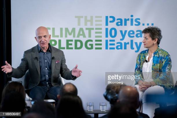 Jeff Bezos, founder and chief executive officer of Amazon.com Inc., left, speaks as Christiana Figueres, former climate change chief at the United...