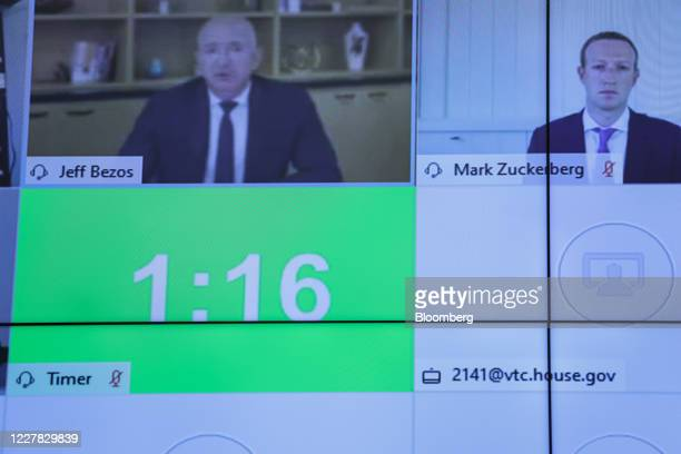 Jeff Bezos, founder and chief executive officer of Amazon.com Inc., left, speaks while Mark Zuckerberg, chief executive officer and founder of...