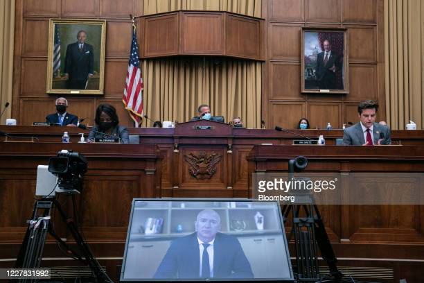 Jeff Bezos, founder and chief executive officer of Amazon.com Inc., pauses while speaking via videoconference during a House Judiciary Subcommittee...